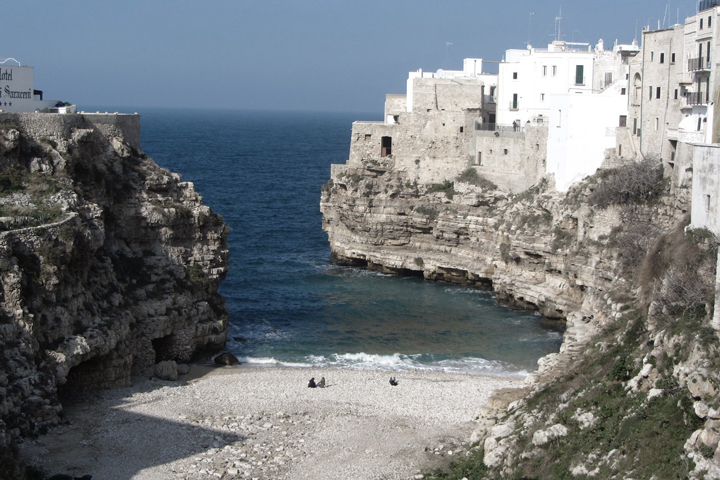 Polignano a Mare's tiny cove photographed by Dixe Wills